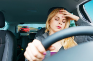 stock-photo-25096068-tired-girl-driving-a-car