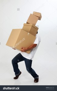 stock-photo-a-man-struggling-to-carry-moving-boxes-38281774